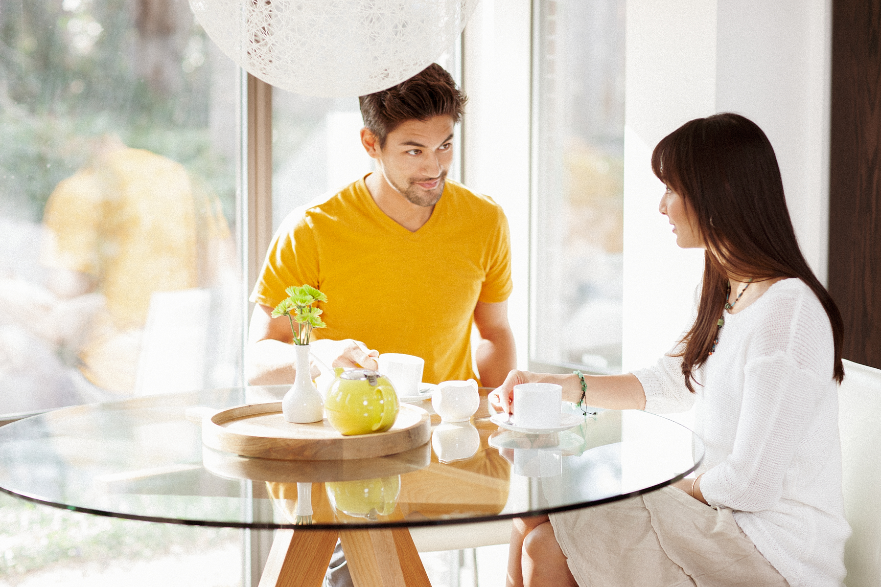 Couple having coffee at kitchen table