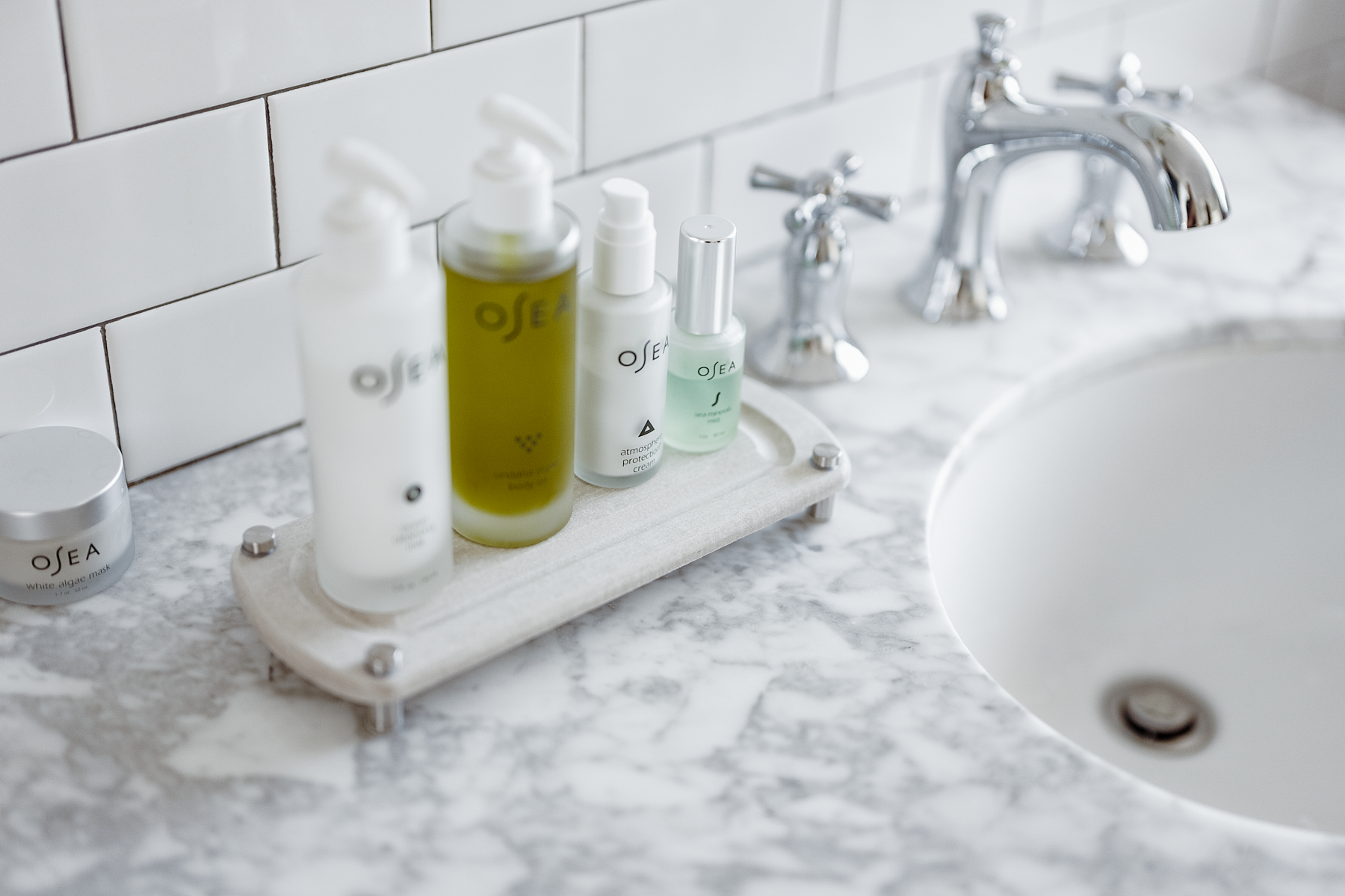 bathroom skin care products on a sink cady