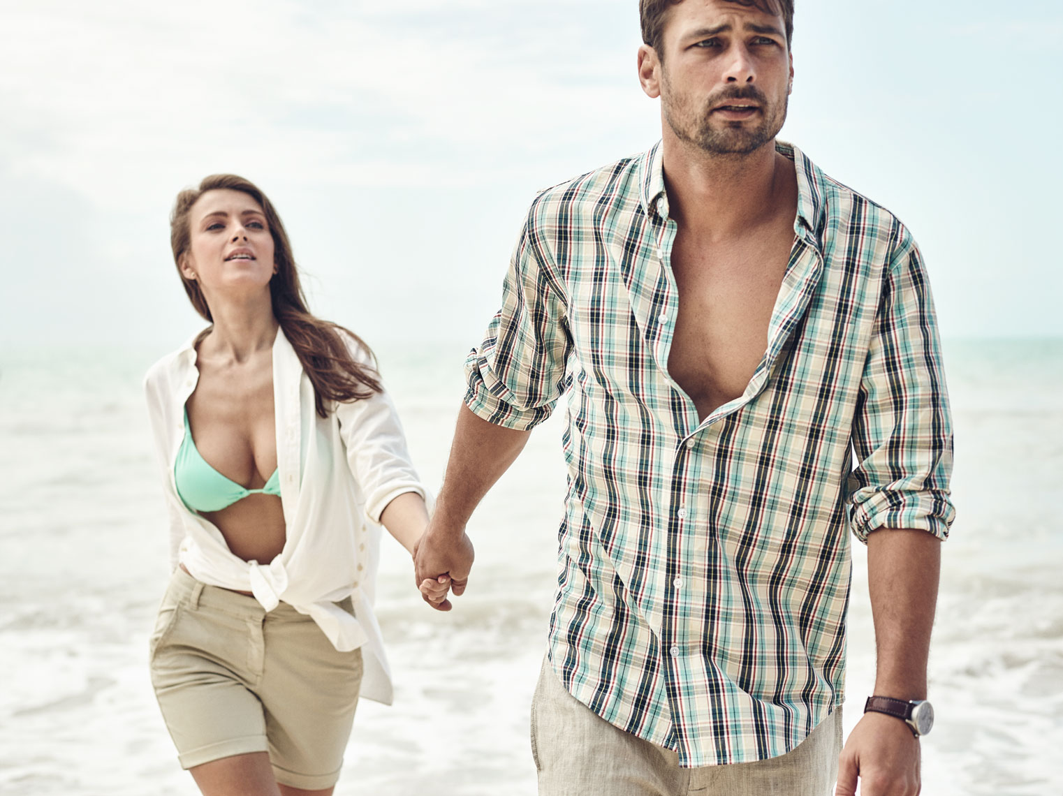 Fashion Lifestyle shoot in key west Florida with couple running on beach in stylish clothes For product branding